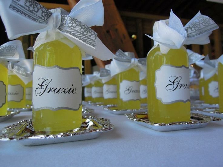 Too perfect for our Italian themed wedding. Homemade limoncello with grazie labels! #favors