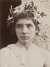 Gloeden, Wilhelm von: Young boy with flower head wreath
