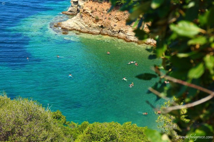 Enjoying the crystal clean waters of Bahia beach - a small cove between high cliffs, Sithonia, Halkidiki