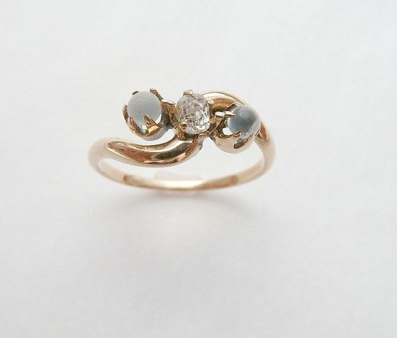 This antique moonstone and diamond ring makes us swoon.