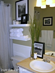 Decorating ideas for a small bathroom.  Like the bead board behind toilet and the floating shelves.