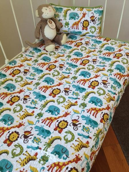 I just love this boys cot quiltfrom the Lovely Linen Store. The gorgeous assortment of zoo animals is perfect for any boys nursery room. Milo the monkey is also available from the Lovely Linen Store #LovelyLinenStore #SafariNursery #CharlieBear