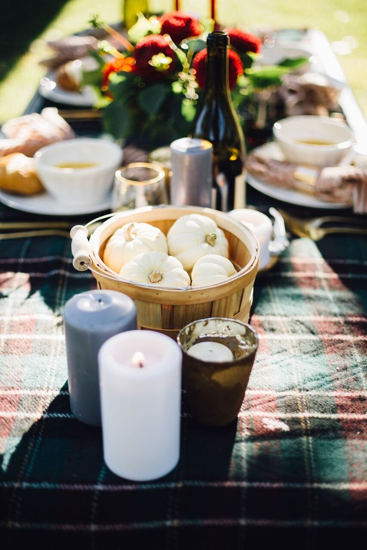 A plaid tablecloth and some gourds are essential to a Fall Al Fresco Dinner Party