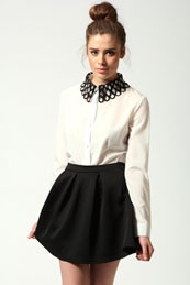 every girl needs a white shirt, and this one has a hectic collar to it
