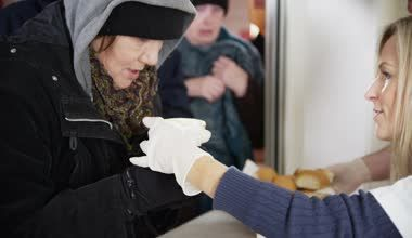 Soup kitchen volunteers help to feed the homeless — Stock Video ...