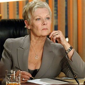 Dame Judi Dench As M: She Took Over The Roll And Has Played The Character From Goldeneye (1995) To The Present, Skyfall (2012). No More Cool Office.