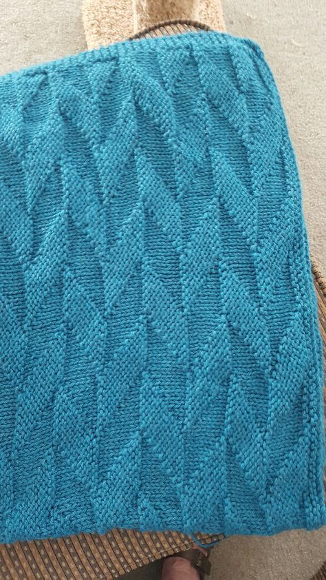 Free Knitting Pattern for Easy Graphic Afghan - A simple repetitive chevron stitch pattern in bulky yarn makes a quick throw. Rated very easy or easy by most Ravelrers. Designed by Sarah Fama. Pictured project by Divagranny.