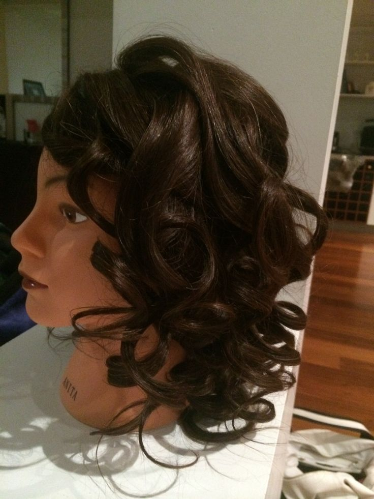 Done using the curling tongs and then pinned.