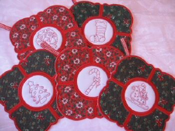 MSP085 - Christmas Heat Pads 1 Quick and easy to stitch out.  An attractive and useful Festive Table Accessory.  Use 'Christmasy' Fabrics to create this eye-catching set. A handy ribbon loop makes these easy to hang up in the kitchen.  There are 10 differently motifed Centres and 5 differently patterned outer edges so you can mix and match to create a unique set each time. http://tinyurl.com/jmp9cq4