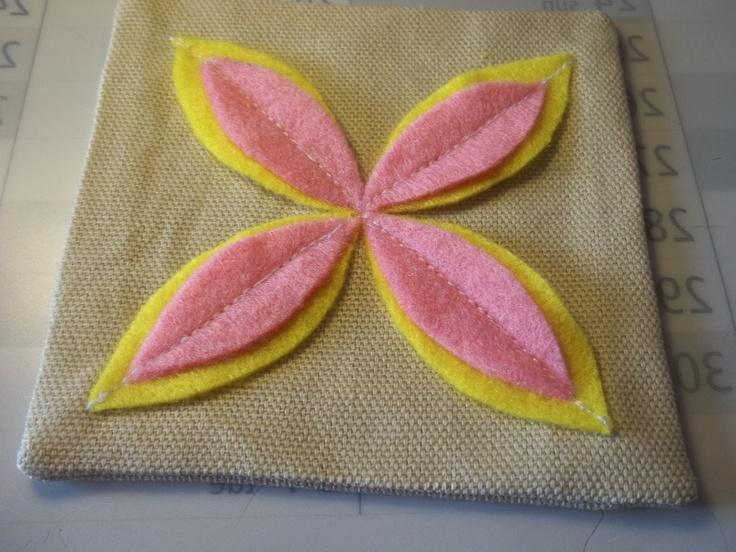 Felt flower sachet. First attempt. Original tutorial: http://www.purlbee.com/the-purl-bee/2013/4/7/corinnes-thread-felt-flower-sachets.html