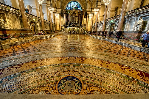 St Georges Hall, Liverpool. Famously the World's first air-conditioned building.  Some 30,000 Minton tiles cover 140ft by 72ft; the mosaic floor was laid in 1852.  The hand-crafted tiles depict tritons, sea nymphs and boys on dolphins, as well as the citys coat of arms. Ref: Liverpool Echo (photo by Dave Wood)