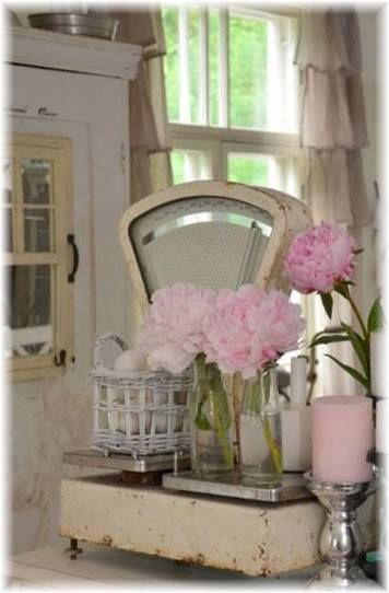 Love the chipped off white paint and the pale pink roses. Just perfect