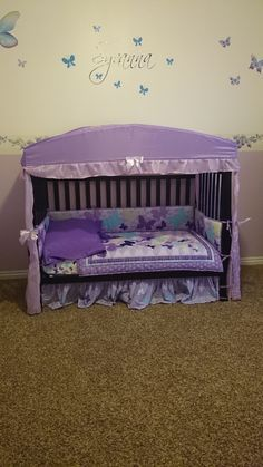 Toddler bed, converted from crib. Found the cute canopy at Ross. Butterflies and name are vinyl stickers