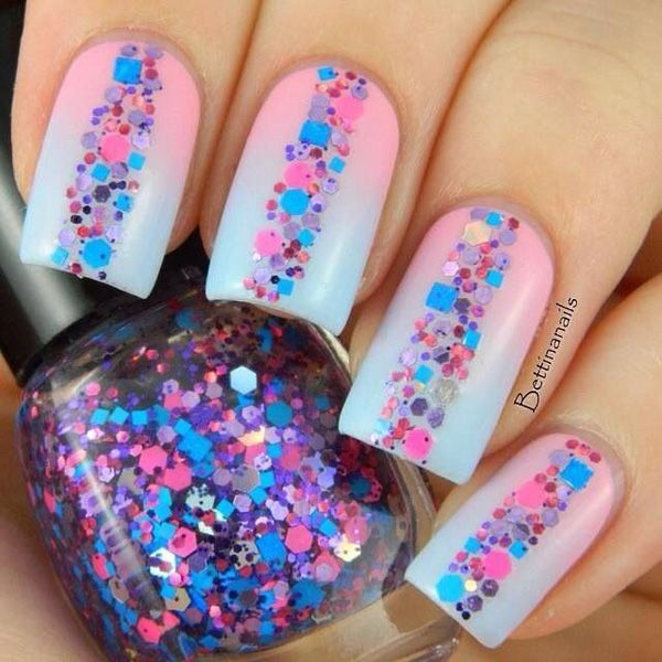 Baby pink and blue themed gradient nail art topped with adorable looking beads.