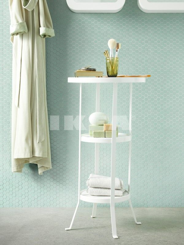 Beautiful side table to keep close to the bathtub and store bath accessories. From IKEA's 2015 Catalog
