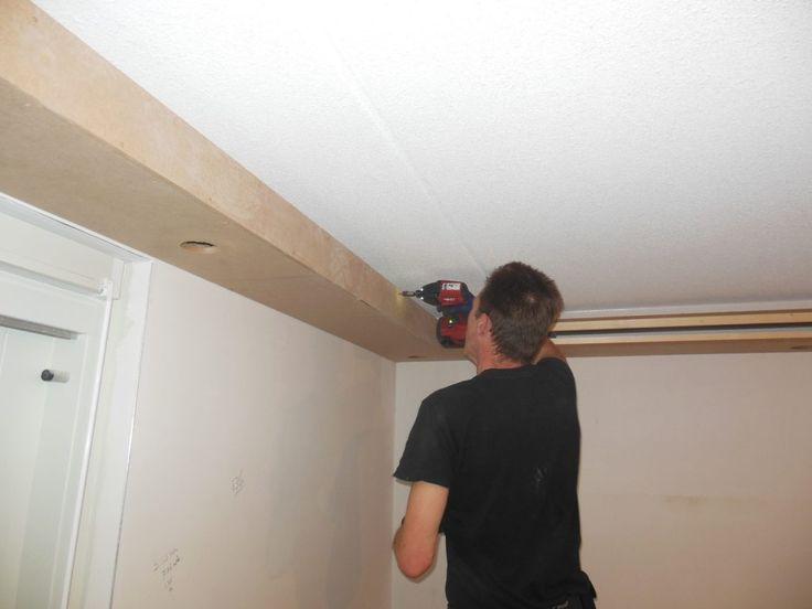 Koof in de woonkamer met ingebouwde spotjes | Demaklussen