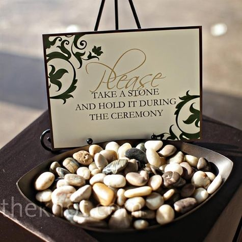 "In lieu of a unity candle, guests can hold stones during the ceremony. They now sit in their home as ""loving wishes."""