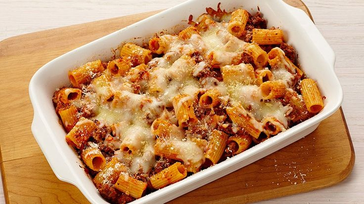BAKED RIGATONI WITH BEEF. Treat your family to a hearty and cheesy casserole dinner tonight with this flavorful recipe for baked rigatoni with ground beef.