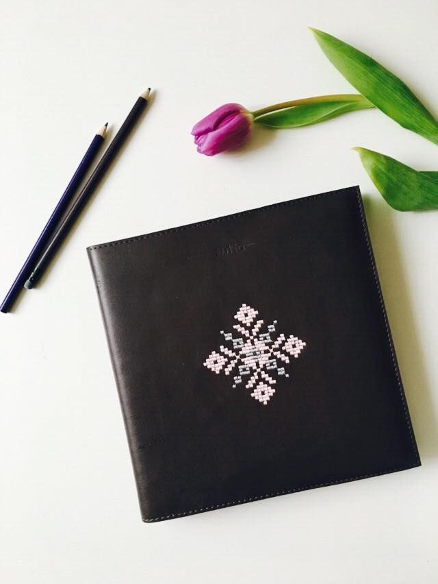 Black leather bound planner with light pink embroidery. Comes in three sizes: small, medium and large, as well as different colours of soft leather. #organized #business #woman #planner #notebook #designer