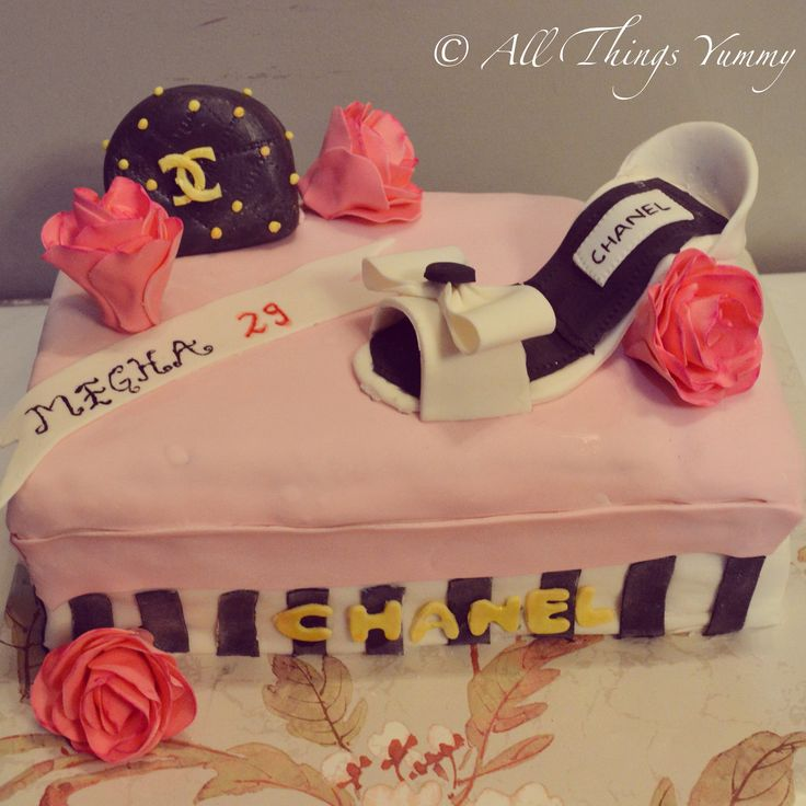 """All things girly"" .. A shoe box cake .. No guesses for the birthdays girls favourite brand :) #chanel #heels #shoes #footwear #shoebox #purse #bag #roses #pinkroses #flowers #gumpaste #edibleflowers #sugarart #bow #gold #stripes #girly #birthdaycake #cake #designercake #customisedcake #customised #branded #brand #atyummy #chocolatecake"