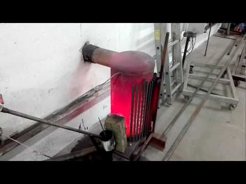 rocket stove, Gravity fed pellet burner Heats a 300 ltr water tank - YouTube