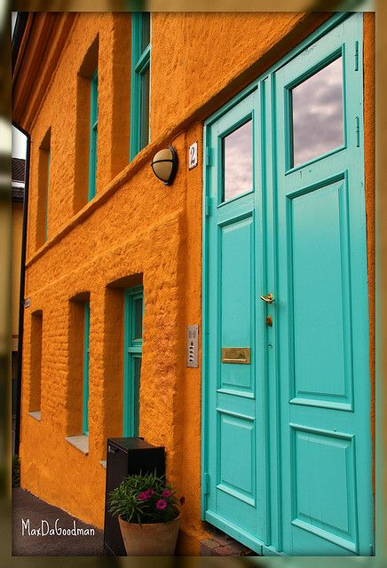 Living in turquoise and orange    Colorful house at Kampen in Oslo, Norway.