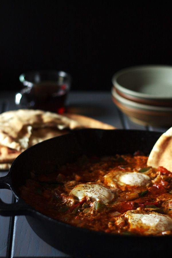 Shakshuka Recipe for Your Next Brunch.Eggs over a bed of skillet tomatoes and green peppers! Flavor packed with Mediterranean spices. A Must try! http://www.themediterraneandish.com/shakshuka-recipe-next-brunch/