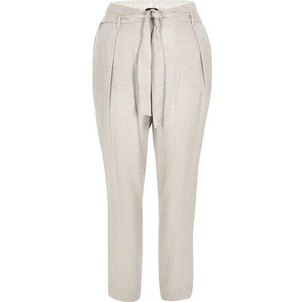 River Island Grey tie waist tapered pants ($70) ❤ liked on Polyvore featuring pants, grey, tapered pants, women, tapered trousers, taper cut pants, river island, grey trousers and tapered leg pants