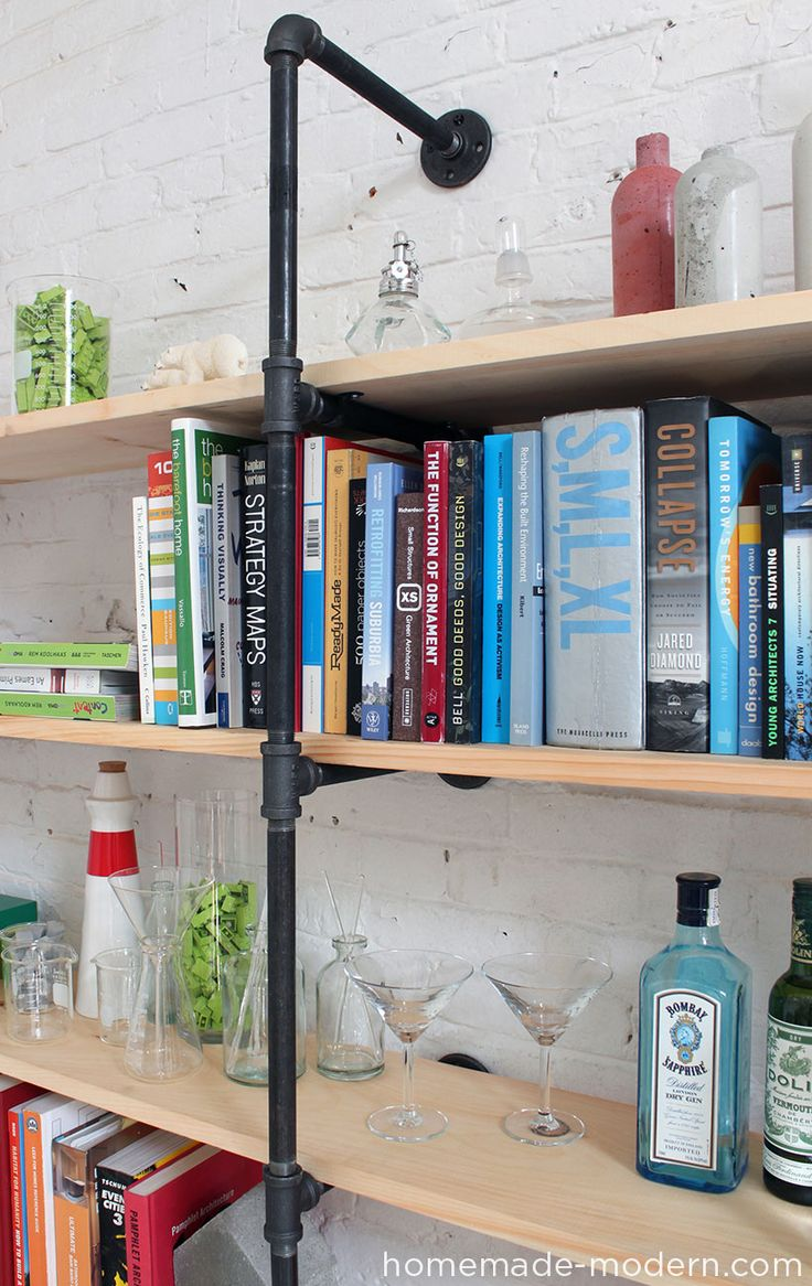 Make customizable shelves out of plumbing pipe with HomeMade Modern.