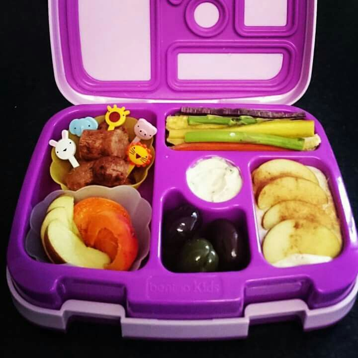 Beef and vegetable sausage, apricot, apple, blueberries, mixed woodsmoked olives, apple and cinnimon yoghurt, rainbow (purple, orange and yellow) carrot sticks, baby corn, baby asparagus, beans and cheese and chives dip.