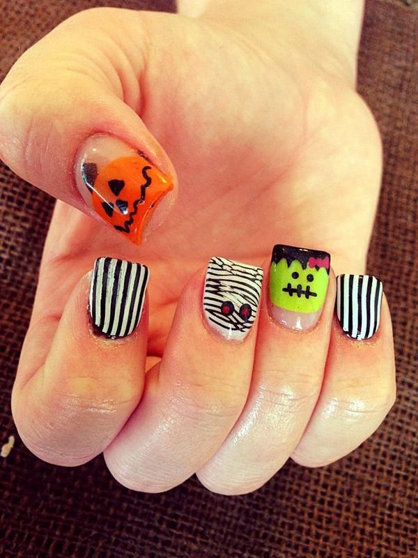 Adorable looking pumpkin and stripes Halloween nail art design. You can also paint on other Halloween characters such as mummies and Frankenstein to create variation.