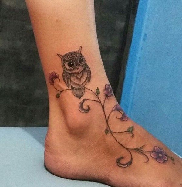 Flower Owl Tattoo on Foot. http://forcreativejuice.com/attractive-owl-tattoo-ideas/