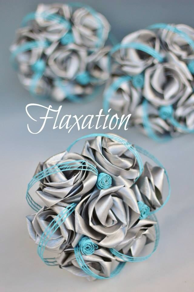 Our most popular bridesmaid bouquets. The seven flower posy. Shown here in silver with buds and loops in ice blue.   www.flaxation.co.nz