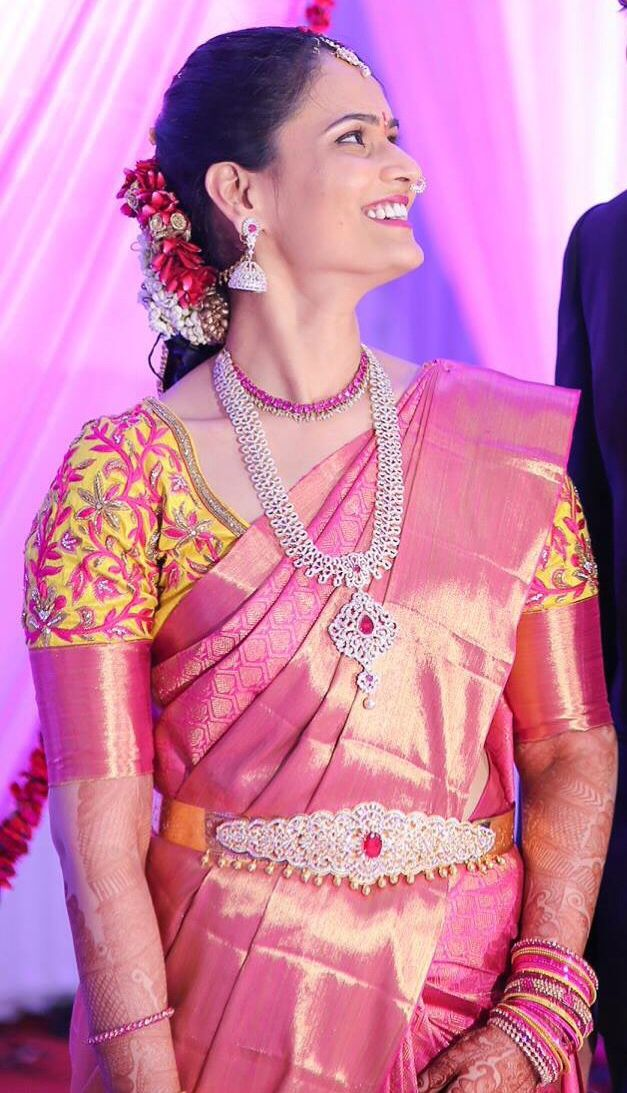 South Indian bride. Diamond Indian bridal jewelry. Jhumkis.Pink kanchipuram sari with contrast yellow blouse.Braid with fresh jasmine flowers. Tamil bride. Telugu bride. Kannada bride. Hindu bride. Malayalee bride.Kerala bride.South Indian wedding