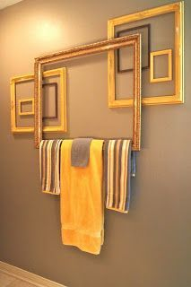 towel bar from frames...really unique idea. Art work and practical