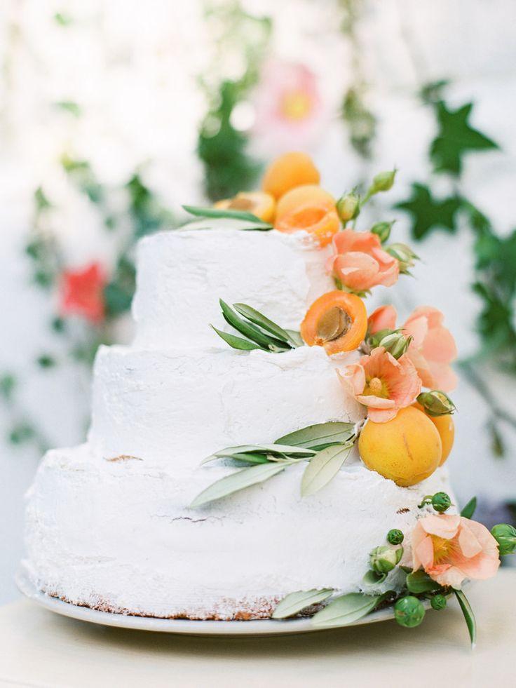 Wedding cake adorned with apricots and poppies | photo by Elena Pavlova | Fab Mood - UK wedding blog #weddinginspiration
