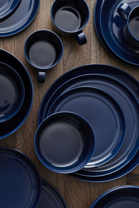 Our fresh, handcrafted porcelain pattern from designer Aaron Probyn tells a mix and match color story, hand-glazed in soft and rich hues. Navy blue dinner plate has a simple artisanal shape with grooved detailing and a glossy finish. Due to the Hue collection's handcrafted nature, each piece will vary slightly.