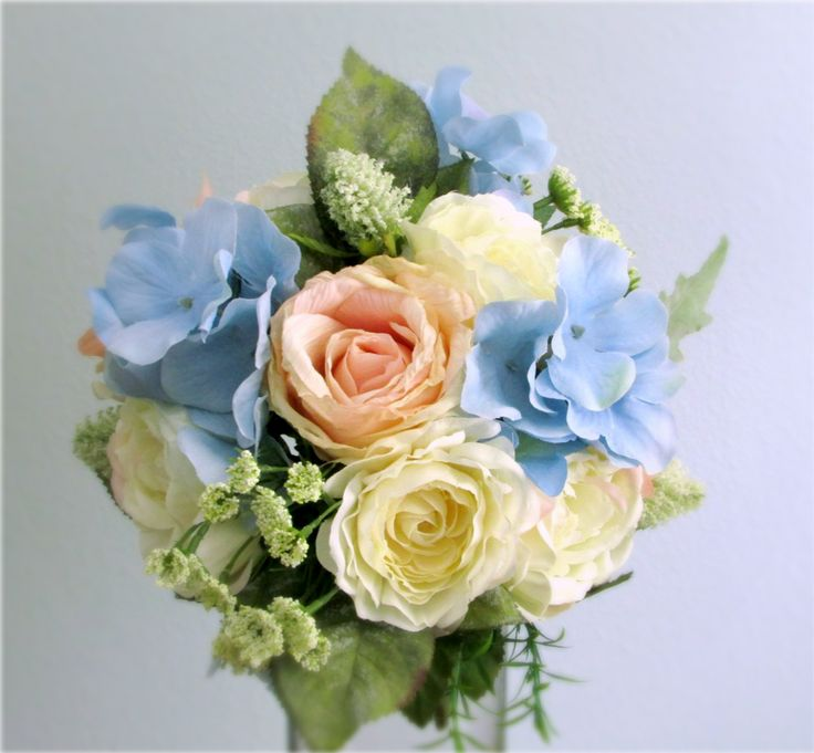 Blush Pink, Cream, and Light Blue Bridal Bouquet with Roses, Camellias, Hydrangea, Queen Anne's Lace, Thistle, and Dusty Miller wrapped with Ivory Satin