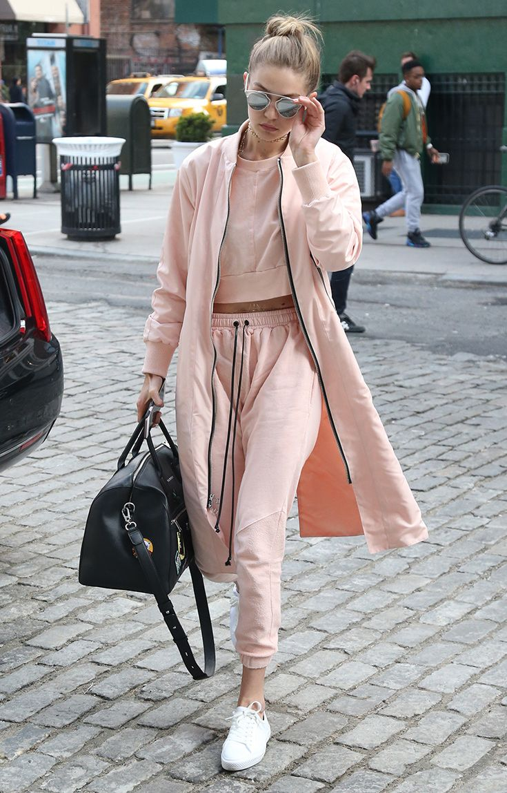 Gigi Hadid just turned the whole idea of a trackie on its head with this three-piece blush suit, with a longline bomber jacket and fresh white sneakers. Guess this is what they mean when people say tracksuits can be chic.