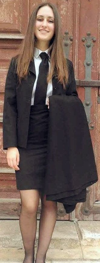 Student Girl Dressed Formal In Black Skirt Suit White Shirt And Black Tie