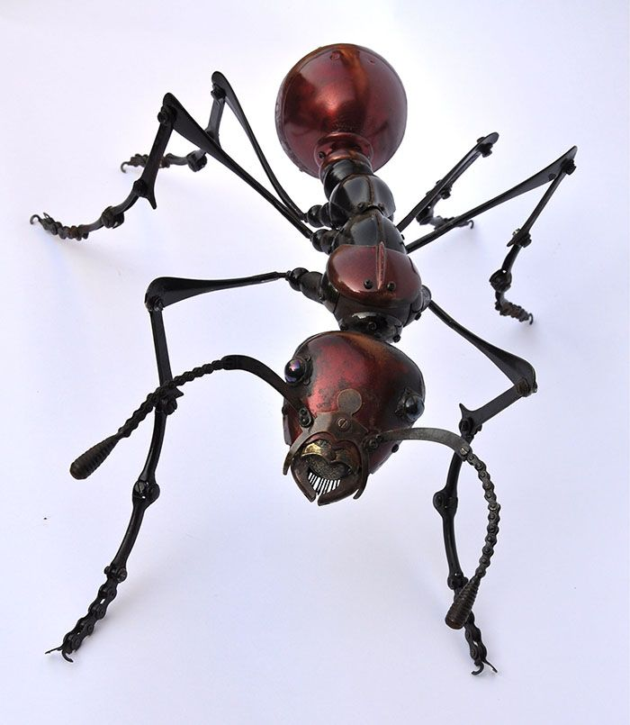 Edouard Martinet / Red ant: 65X42X22 cm Thorax and head : sauce spoons, car parts  Eyes : marbles  Abdomen : bike or motorbike headlights Antennae: small bike chains Legs: cream chargers , brake parts , chains, alarm clock feet , spoon handles