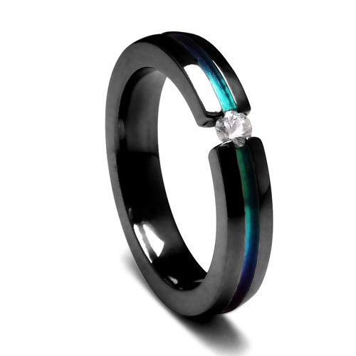 "How about a ""floating"" stone?  Edward Mirell 4mm Black Titanium and White Sapphire Tension Set Ring"