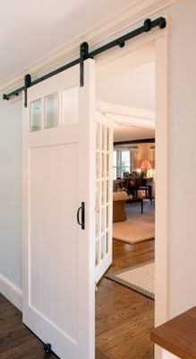 Sliding barn door. Perfect for turning a formal living or dining room into an office, guest room, or any room that might need privacy.