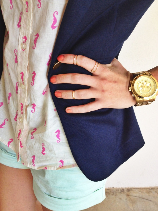 Pink seahorse button up from target, mint shorts, a navy blazer and gold jewelry.