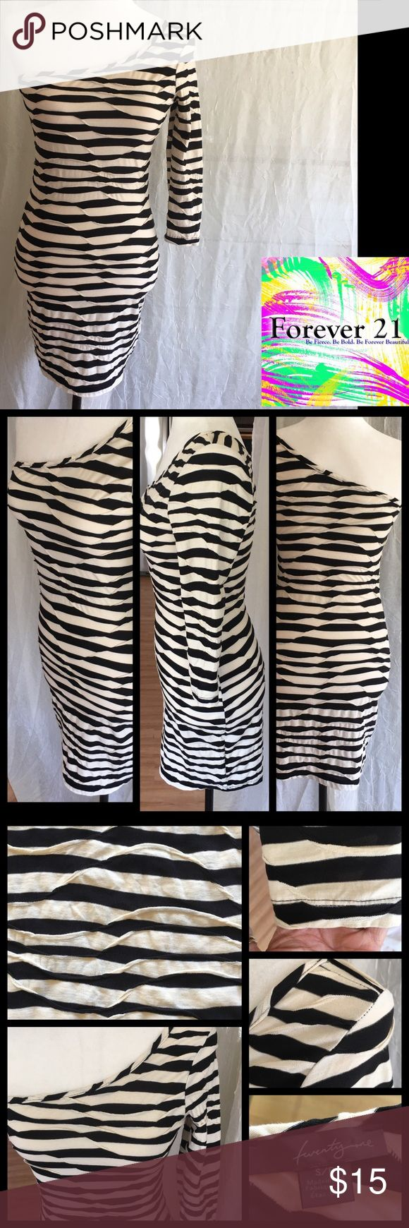 NWOT Forever 21 Striped One Shoulder Bodycon Dress Ready for the club scene this Bodycon outfit features multi tiered fabrics overlapping. Very unusual. Please see pics. One shouldered and Striped in ivory and black. NWOT 50% cotton 50% polyester  Sz S/P Forever 21 Dresses One Shoulder
