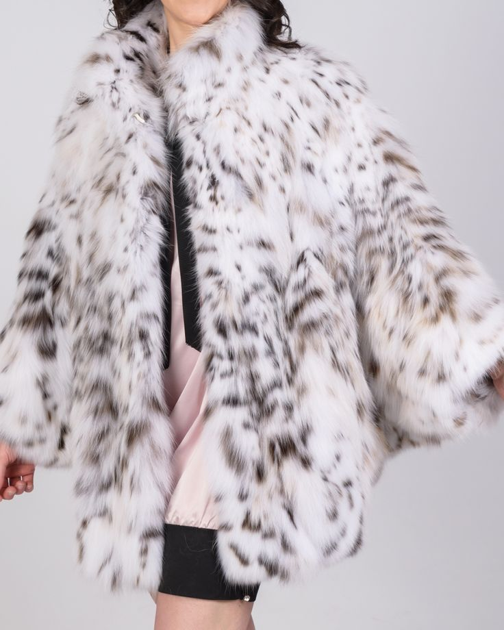 Luxury or wildness? This lynx cat fur jacket defines them both.