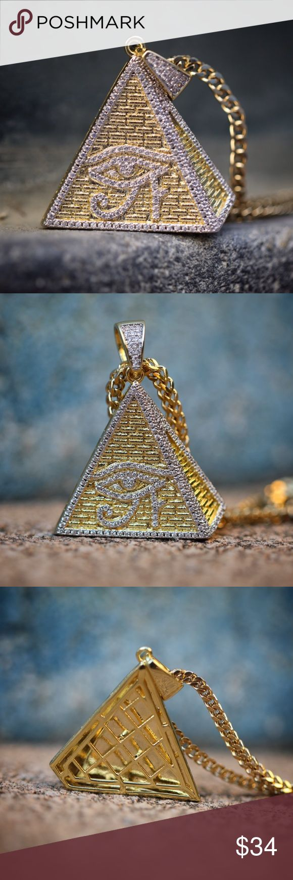 Egyptian Pyramid Eye Pendant With Franco Chain Men's Hip Hip Gold Egyptian Pyramid Eye Pendant With Franco Chain  Chain is made of 316 stainless steel with a 14k gold plating on top.  Size is 40mm in length.  Iced out with white simulated diamonds.  Comes with a 2.5mm width 22,24 or 26 inch 14k gold plated 316 stainless steel franco chain. Tsv Jewelers Accessories Jewelry