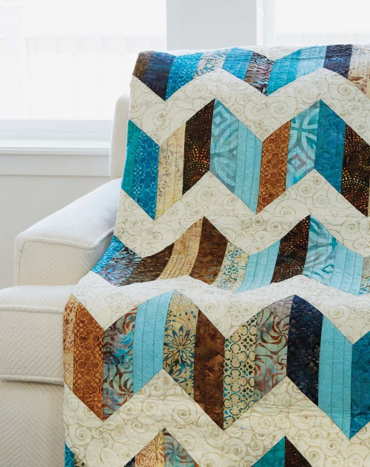 Sand and Sea quilt pattern: Dig into your pre-cut strips to make a quick and easy chevron quilt, and make the bonus units for an entirely new quilt! Design by Scott Flanagan