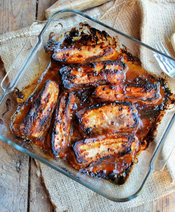 Oven Baked BBQ Pork Belly Slices 475g British pork belly slices Sauce 4 tablespoons tomato ketchup 2 tablespoons brown sugar 1 tablespoon liquid smoke, or ready-made barbecue sauce 1 tablespoon Worcestershire sauce 1 tablespoon rapeseed oil 1 tablespoon cider apple vinegar 1 tablespoon soy sauce 1 teaspoon English mustard 1 teaspoon garlic granules 1/2 teaspoon ground ginger 450F for 45 minutes