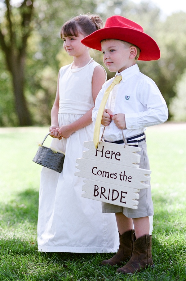 how cute is this ring bearer in shorts and cowboy boots and a bright red hat?! via DIY BRIDE - photo by Amy Majors Photography